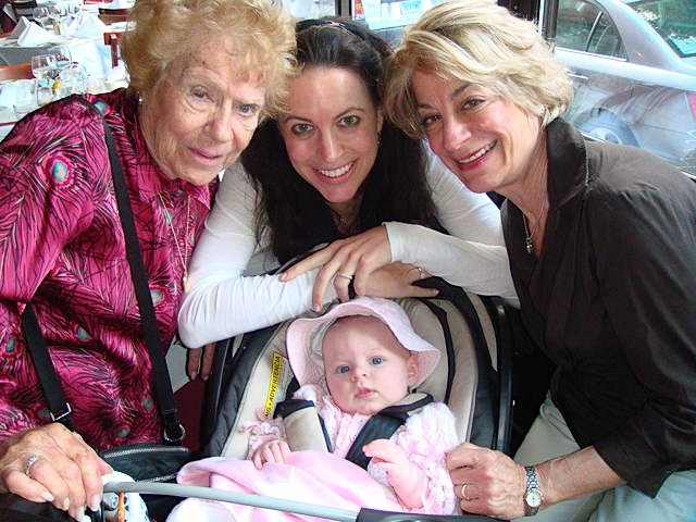Four generations: Lisa (center) with her grandmother (left), mother (right), and baby.